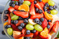 Closeup of fresh healthy fruits salad on old wooden table Royalty Free Stock Images