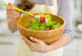 Closeup on fresh vegetable salad in hand of woman Stock Image