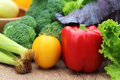 Closeup of fresh vegetables on wooden surface Royalty Free Stock Photos