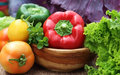 Closeup of fresh vegetables on wooden surface Royalty Free Stock Photography