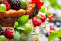 Closeup of fresh wild berry fruits in a cake on old table Royalty Free Stock Photo