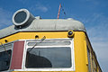 Closeup frontal view of an old diesel locomotive against the bac background blue sky and white clouds transport technology Stock Photos