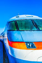 Closeup frontal view of an old electric high speed locomotive ag against the background clear blue sky transport technology the Stock Photo