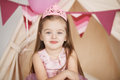 Closeup funny little princess girl in pink crown and dress Royalty Free Stock Photo
