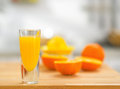 Closeup on glass of fresh orange juice and oranges Royalty Free Stock Photo