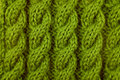 Closeup of green cable knitting stitch Royalty Free Stock Photo