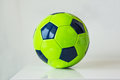 Closeup, of green soccer ball on a white background. Hobby concep