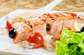Closeup grilled salmon shrimps tomatoes peppers bamboo sticks Royalty Free Stock Images