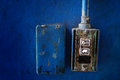 Closeup grunge light switch on blue wall Stock Image