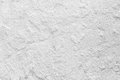 Closeup grunge texture white paint cement wall. Royalty Free Stock Photo