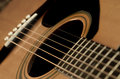 Closeup of guitar strings for music detail playing instrument talent strum strumming Royalty Free Stock Photos