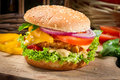 Closeup hamburger chicken vegetables old wooden table Royalty Free Stock Photography