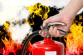 Closeup hand handle fire extinguisher Royalty Free Stock Photo