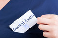 Closeup hand hold visit card with dental exam