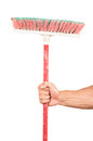 Closeup of hand holding a broom isolated on white Stock Images