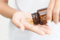 Closeup hand holding fish oil vitamin Royalty Free Stock Photo
