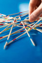 Closeup of hand with pick-up-sticks Royalty Free Stock Photo