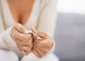 Closeup on hand pushing pill out of blister package Royalty Free Stock Photo