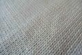 Closeup of handmade plain white stockinette stitch knitwork Royalty Free Stock Photo