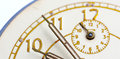 Closeup of hands on clock face Royalty Free Stock Photo
