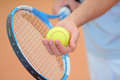 Closeup hands holding tennis racket and ball poised to serve Royalty Free Stock Photo