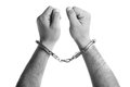 Closeup of the hands of a man with handcuffs Royalty Free Stock Photo