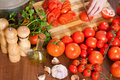 Closeup of hands slicing tomatoes in home kitchen Royalty Free Stock Images