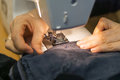 Closeup, of hands a yong woman on the sewing machine, stitching t