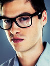 Closeup of a handsome young man in glasses Royalty Free Stock Images