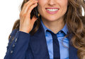 Closeup on happy business woman talking cell phone isolated white Stock Photography