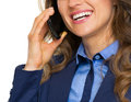 Closeup on happy business woman talking mobile phone isolated white Stock Images