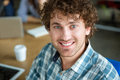 Closeup of happy curly handsome man in checkered shirt smiling looking camera Royalty Free Stock Photos