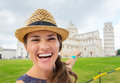 Closeup of happy female tourist pointing to Tower of Pisa Royalty Free Stock Photo