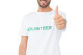 Closeup of a happy male volunteer gesturing thumbs up over white background Royalty Free Stock Images