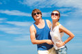 Closeup of happy young couple in sunglasses enjoying their time on tropical beach this image has attached release Royalty Free Stock Photo