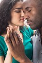 Closeup of happy young woman with boyfriend spending time together portrait african couple on white background Stock Photos