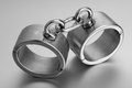 Closeup of hard steel handcuffs or cuffs a Royalty Free Stock Images