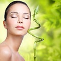 Closeup healthy face of young woman with sprout in hands over nature green background Royalty Free Stock Photos