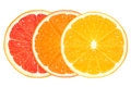 Closeup of healthy fresh citrus fruits clean eating lemon orange and grapefruit slices isolated on white background diet and Stock Image