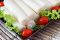Closeup of Heart of palm (palmito) with cherry tomato Royalty Free Stock Photo