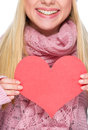 Closeup on heart shaped postcard in hand of girl winter clothes Royalty Free Stock Photography