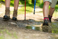 Closeup of hiker legs wearing trekking boots walking through the water Stock Photo