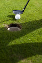 Closeup of hole on golf field Royalty Free Stock Photo