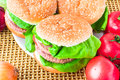 Closeup homemade hamburger fresh vegetables Royalty Free Stock Photos