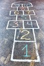 Closeup of hopscotch drawn with chalk on asphalt road. Children Royalty Free Stock Photo