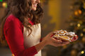Closeup on housewife enjoying with plate of christmas cookies Royalty Free Stock Photo