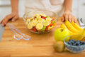 Closeup on housewife making fresh fruit salad Royalty Free Stock Photo