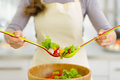 Closeup on housewife mixing vegetable salad Royalty Free Stock Photo