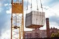 Closeup image of crane lifting heap of bricks at blue sky Royalty Free Stock Photo