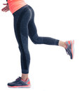 Closeup image of female fitness legs in sports wear isolated on a white background Stock Photography